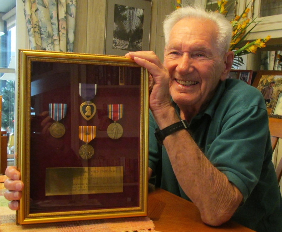 Cynkar holds a shadow box of military commendations. He received a Purple Heart, Asiatic-Pacific Theater Medal with two battle stars and the World War II Victory Medal, and the American Defense Medal. Sun photo by Don Moore