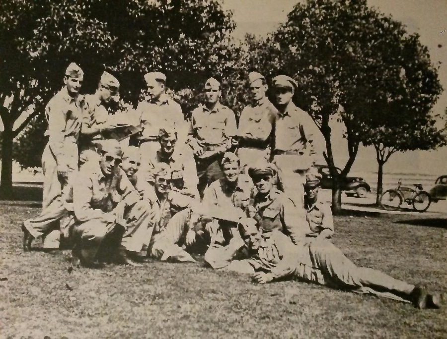 Lt. McGrath, with his ball cap and Rayban glasses in the foreground takes it easy with some buddies somewhere in the Pacific during World War II. Photo provided by Jim McGrath