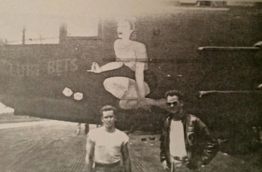 Jim McGrath and Dick Ramstack, another B-25 pilot in his unit, stand beside the B-25 Mitchell bomber McGrath flew built by North American Avation. The nose art was taken from an Esquire magazine pinup of the day. The plane was named for his wife, Betty . Photo provided by Jim McGrath