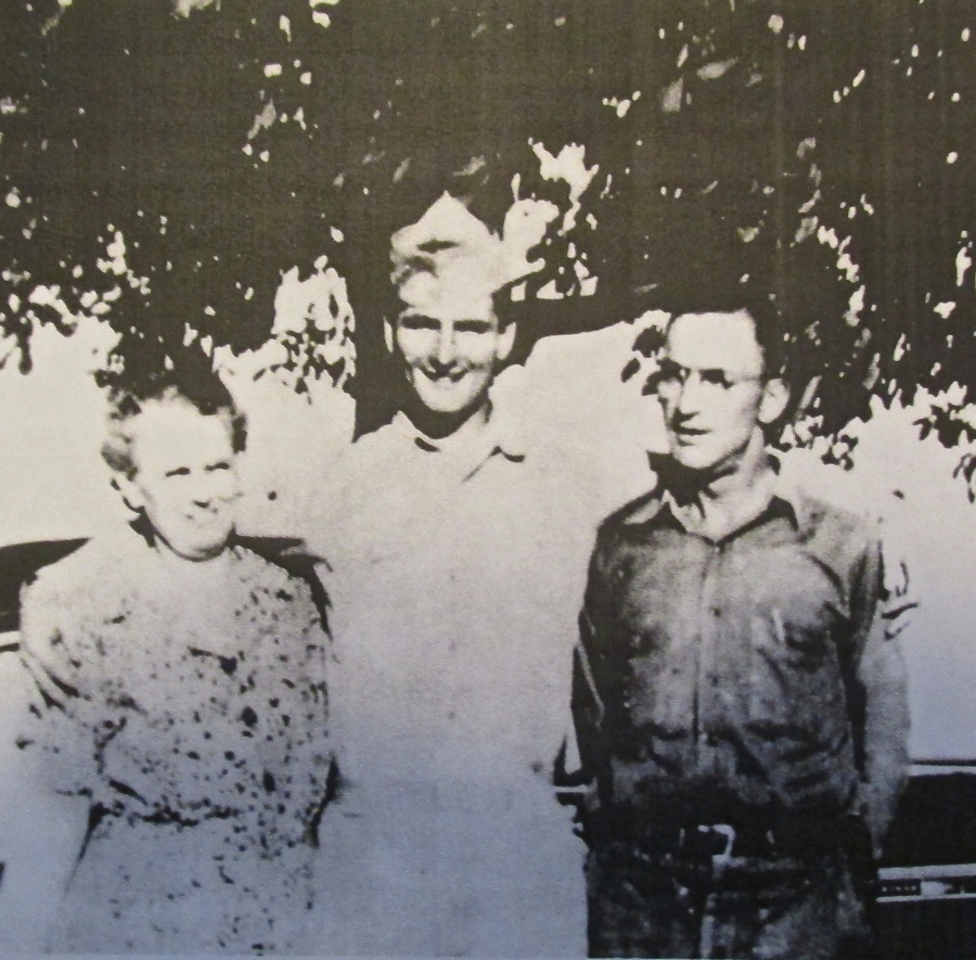 Meadows is shown with his mother and father, Maude and Jesse Meadows, in 1943, just before shipping out overseas at age 19. This picture was taken at his father's Gulf service station in Flint, Mich. Photo provided