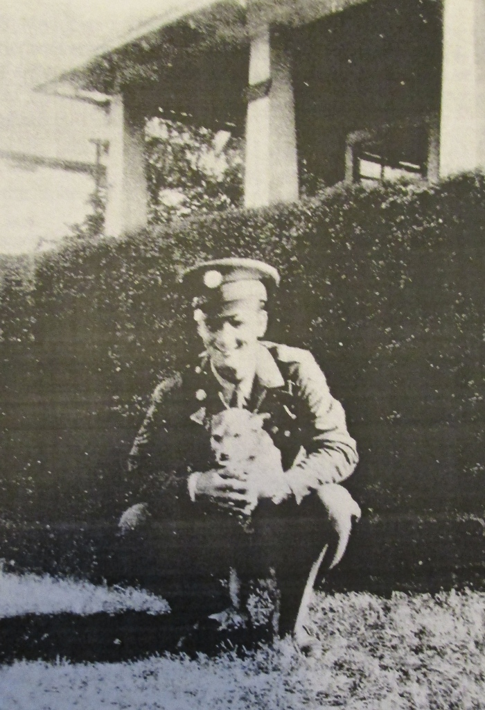 Meadows holds on to Bootsie, his pup, in the front yard of his parents' home in Flint. Photo provided