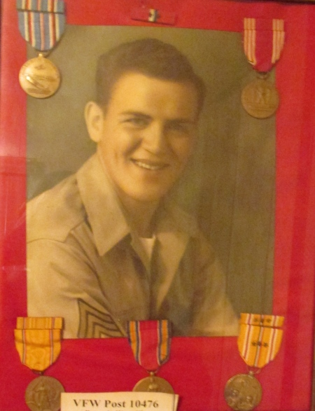 This picture that hangs on Henry Cwiklinski's bedroom wall is a shot of him during the war when he was a sergeant who took part in the recapture of Leyte Island in the Philippines during World War II. Photo provided