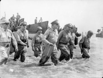 "Gen. Douglas MacArthur comes ashore on Leyte in the Philippines in October 1944 during the battle and tells the people of the Philippines, ""I have returned."" U.S. Army Photo"