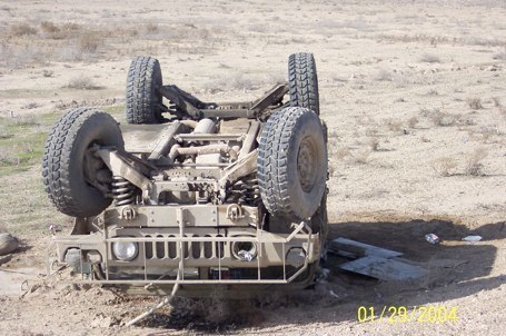 """The major's Humvee was a disaster after it was hit by an """"Improvised Explosive Device"""" on a highway outside Fallujah, Iraq on Jan. 29 2004. He suffered traumatic brain injury and nerve injury to his ear. Photo provided"""