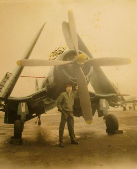 Cpl. Pete Peterson, a Marine aviation mechanic, stands in front of a Corsair fighter plane with folded wings at the Cherry Point, N.C. Naval Station. It was 1948 and he was 19-years old and a member of Marine Corps Squadron VMF-222 at the point. Photo provided