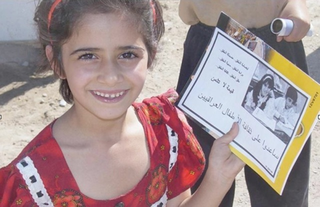 The young Iraqi girl is all smiles as she shows off her first report cad with all As. For the first time in her life she was atending a school which Ponkratz and the soldiers of the 432nd Civil Affairs Battalion buil in the Falluah area. Photo provided