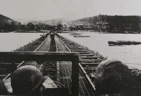 Lt. Holland, at the left, and Al Meersman of Port Charlotte, Fla. on the right, take a Jeep across the Rhine River on a pontoon bridge at Remagen after the original bridge collapsed during World War II. Photo provided