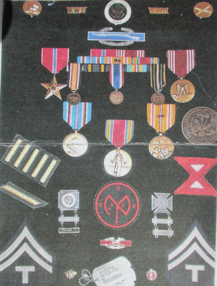 "Former Sgt. Bobbie Caho has a shadowbox full of medals he received during his time with the 27th Infantry Division in the Pacific in World War II. To go with his Tech Sergeant stripes he received the Combat Infantryman's Bade, Bronze Star with ""V"" for valor and World War II Victory Medal among others. Photo provided"