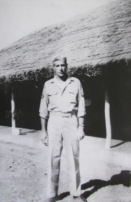"Sgt. Bill Langley of Port Charlotte, Fla. stands in front of his thatched-roofed barracks ousted Calcutta, India during World War II. He was a radio operator on a B-29 ""Superfortress"" that bombed Tokyo. Photo provided"