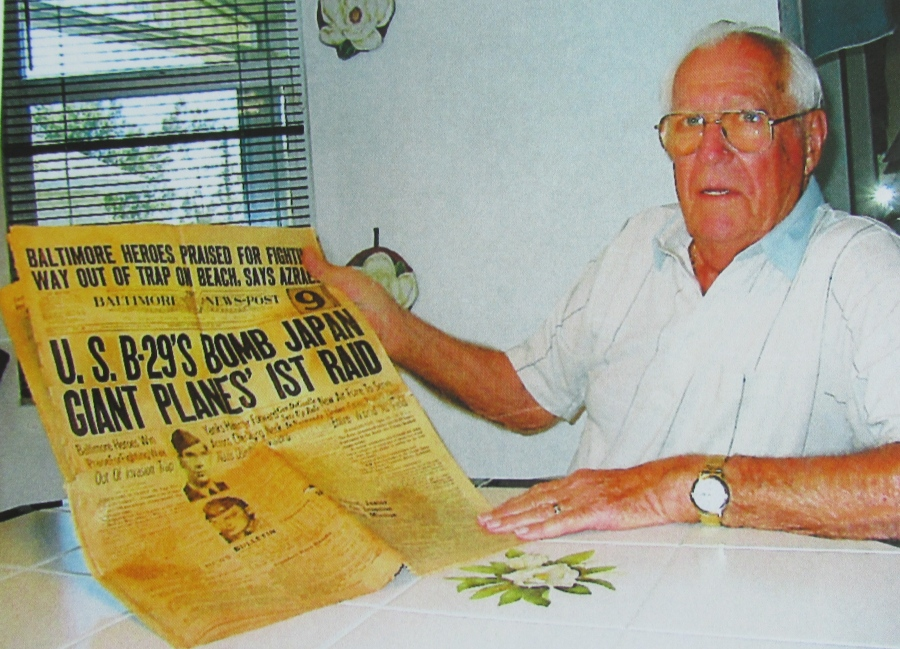Bill Langley holds the front section of the newspaper proclaiming the first raid by B-29 Superfortresses on Japan near the end of World War II. He was in that raid almost than 70 years ago. Sun photo by Don Moore