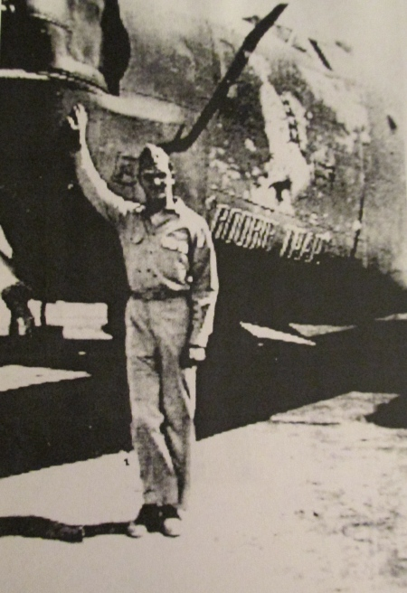 "Staff Sgt. Wilbur Butler stands next to ""Boobie Trap"" a beat up old B-24 Liberator"" that got him home every time no matter how bad the mission. Photo provided"