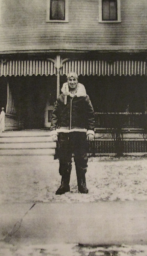 Butler stands in front of his Pennsylvania  home during the war in his sheep skin lined flying suit. Photo provided