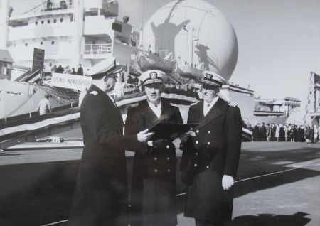 Capt. Bill Reddel (right) with a couple of Navy admirals at the Philadelphia Navy Yard where the satellite communication ship USS Kingsport was refurbished and sent to sea. Note the big spherical radome on the ship in the background. Photo provided