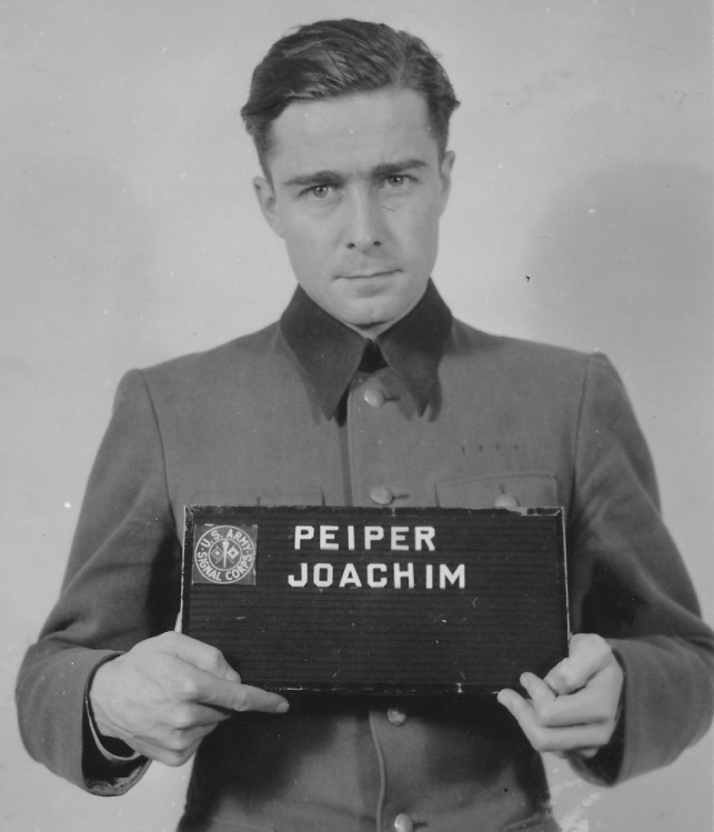 "Col. Joachim Peiper, commander of the 1st SS Panzer Division, was the officers who ordered the ""Malmedy Massacre."" Shortly after the war he was tried and hanged for his part in the mass shooting of 84 POWs. U.S. Army photo"
