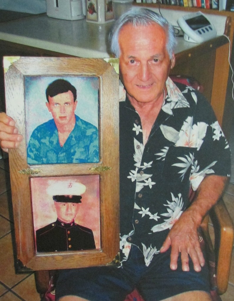 Stanley Firoini of Port Charlotte holds photos of his two sons, William and Gary, when they served in the U.S. Marine Corps during the Vietnam era. Standly was a deckhand on a landing craft that brought Marines ashore in the first wave during the Battle of Iwo Jima in World War II. Sun photo by Don Moore