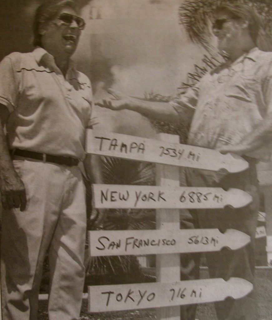 Sal Russotto of Port Charlotte, left, and Charles Wilson of Tampa, look at a sign that gives soldiers the distances from Korea to Tampa, New York, San Francisco and Tokyo. Sun photo by Jonathan Fredin