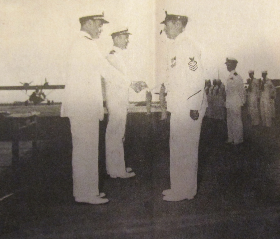 Chief Arcidiacomo, right, is presented two Distinguished Flying Crosses. Photo provided