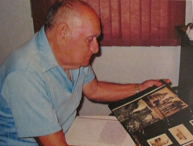 Pete Marlo looks at a scrapbook full of pictures of himself  when he served with the 62nd  Anti-aircraft Artillery Battalion  attached to Patton's 3rd Army in World War II. Sun photo by Don Moore