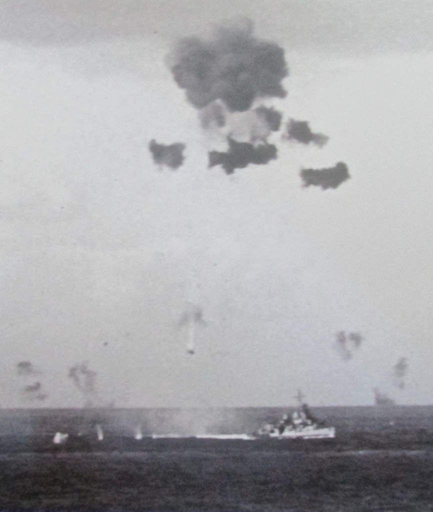 A Japanese kamikaze disintegrates above the deck of the USS John Rodgers, a Fletcher-Class destroyer, somewhere in the pacific during the Second World War. Photo provided