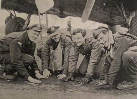Members of his homer crew get ready to kiss the ground after their 35th and final flight over enemy territory in April 1945. Griffith is the one without a hat. Photo provided