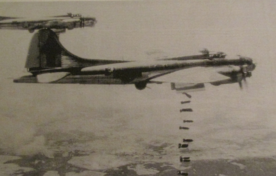 A B-17 bomber drops its bombs over German-held territory during the war. This is a homer like the one Griffith flew in. Photo provided