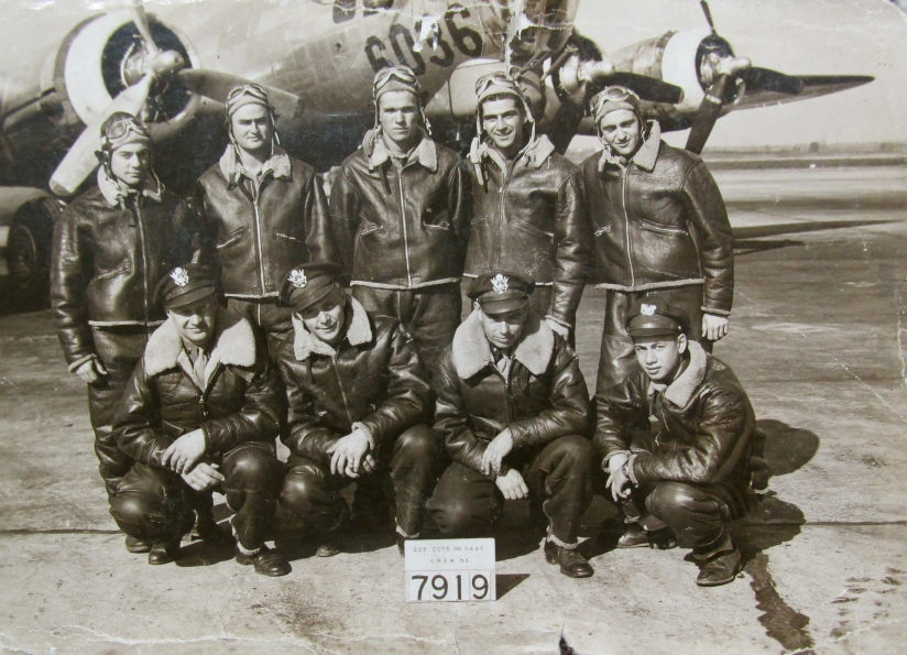 "This is the crew of ""Heaven and Earth,"" a B-17 bomber parked behind them. Staff Sgt. Tristano is the crewman in the back row second from the right. Photo provided"