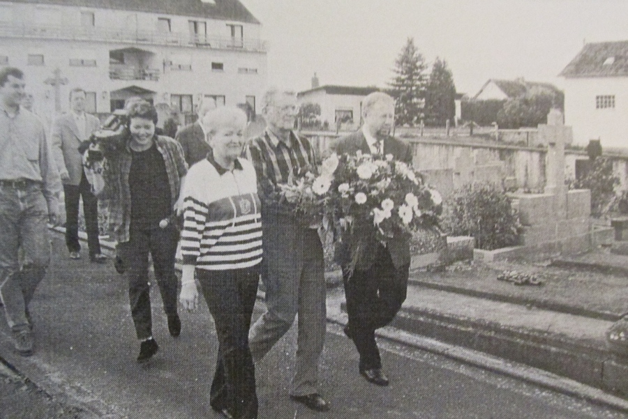 Elmer Meyers (front row center) and his wife, Dorothy, place flowers at a memorial in Fouhren, Luxemburg in 1998 to the fallen in the Battle of the Bulge during World War II. At the far right is the mayor of the town. Photo provided