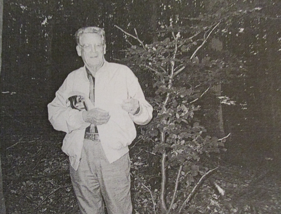 Meyers holds his lost dog tag in the spot in the woods where it was found by museum staff  near Fouhren, Luxemburg. Photo provided