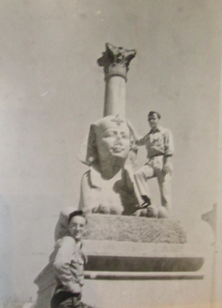 Glenn stands next to a Sphinx and Pompey's Pillar during his trip to  Egypt right after the Second World War. Photo provided