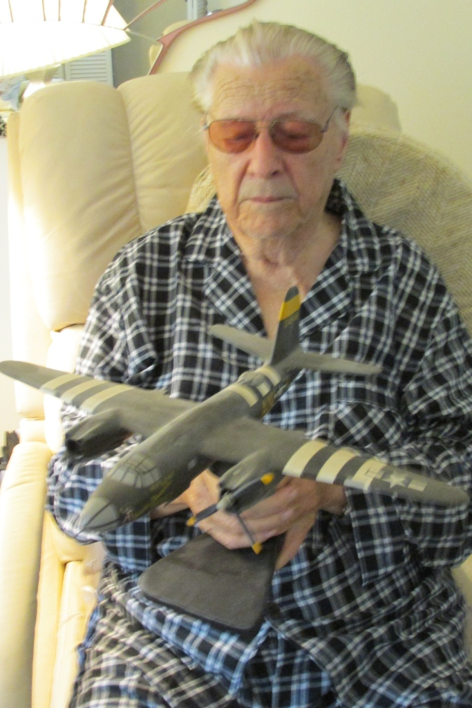 Stanley Ackerman, 96, at his home in Venice holds a model of a B-26 bomber like the one he flew in World War II. Sun photo by Don Moore