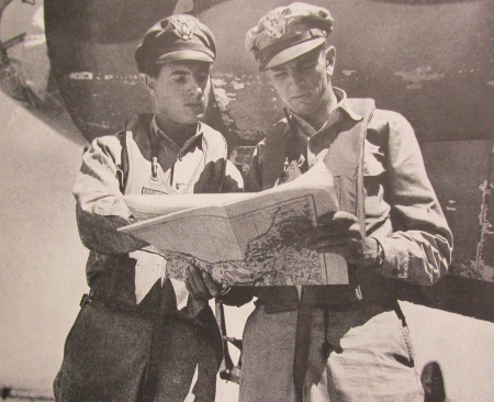 "Standing in the rubble of the railroad yard in Florence, Italy, Capt. Stanley Ackerman of Venice (left), lead pilot for a formation of B-26 ""Marauder"" bombers that caused the damage during World War II, looks at a map with his bombardier, Lt. Mack Mc Cartney. This Army Air Corps picture appeared as part of a large article about Florence during the war written by Mc Cartney that appeared in the March 1945 National Geographic Magazine. Photo provide"