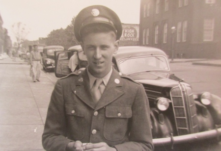 Roth on leave back home in Baltimore, Md. In the background is his father's 1936 Dodge. Photo provided