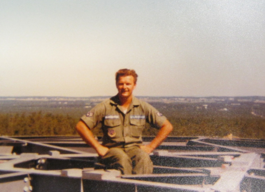 Rabczewski is perched atop a 50-foot microwave tower he was in the process of building while serving in the guard. Photo provided