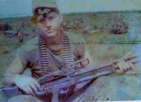 Pfc. Dominic Socci holds a M-60 machine-gun in Vietnam during the 10 months in 1969 he served in the Southeast Asia war. Photo provided