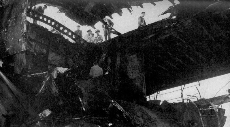 "Another view of the damage done to the flight deck of USS Randolph (CV-15) after hit by a ""kamikaze"" suicide plane on 11 March 1945. Photo provided"