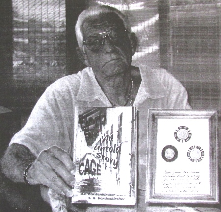 "Don Bordenkircher of Maple Leaf Estates in Port Charlotte holds ""Tiger Cage,"" a book he wrote about his experiences during the Vietnam War, and some chips from Sadam Hussein's casino and bordello newer Baghdad he acquired during his two years of service in Iraq. Sun photo by Don Moore"