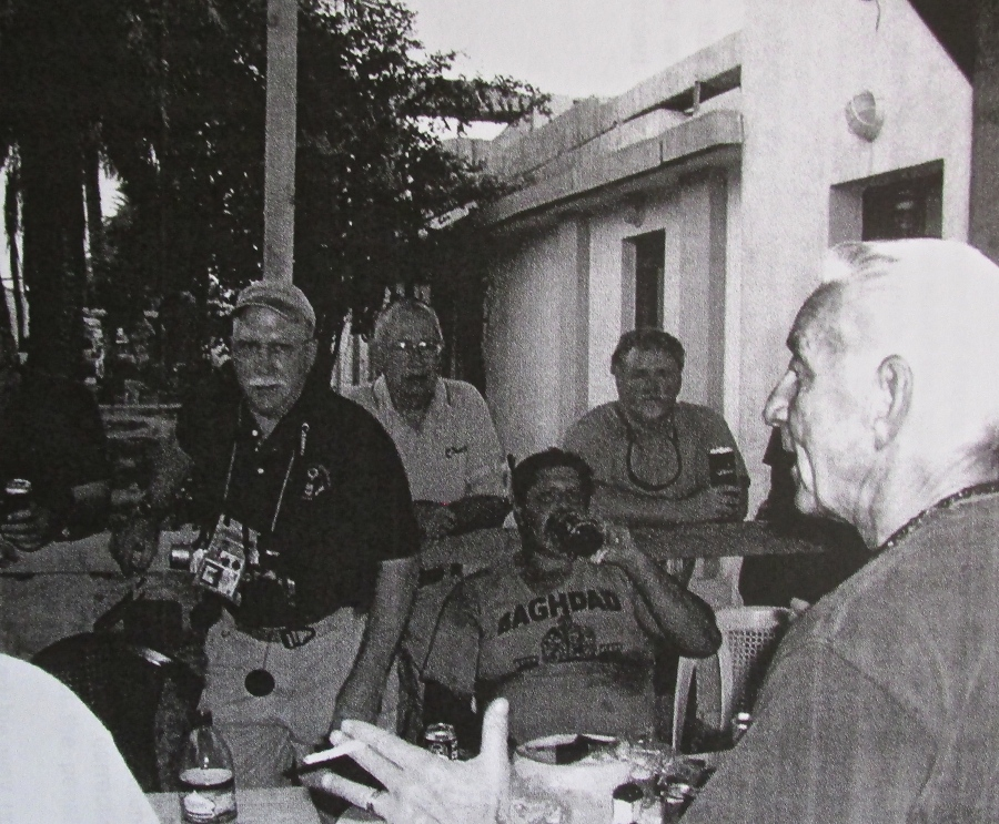 Don Bordenkircher, right foreground, talks to some of his staff in Iraq where he served in 2006 as National Director of All Prisons in Iraq. Photo provided