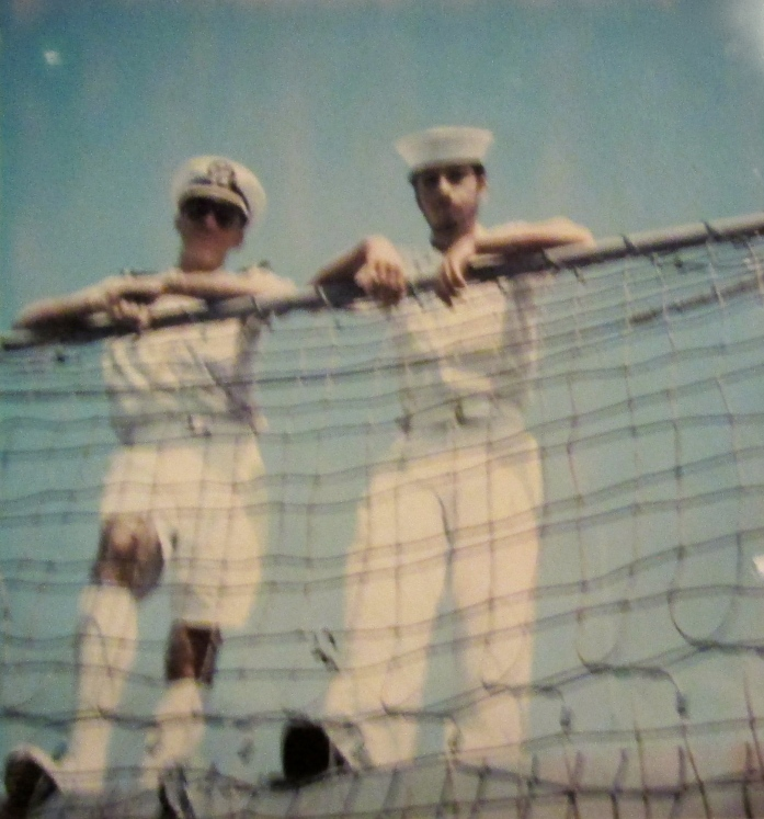 Standing at the railing of the USS Trippe, a destroyer escort, during a cruise to the Middle East in 1973. He's the officer in the Bermuda shorts on the left. Photo provided