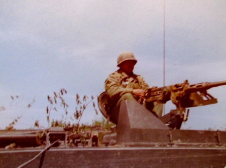 Sgt. Bill Fields of North Port mans a .50 cal. machine-gun atop an armored personnel carrier during his time with the 50th Armored Division in the 1970s. Photo provided