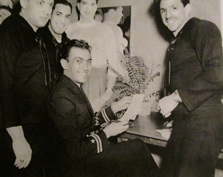 Lt. Eddy Duchin (seated), a well known big band leader before and after World War II with a group of seagoing musicians around him. Saams is the sailor at the right, smiling at the camera. Photo provided