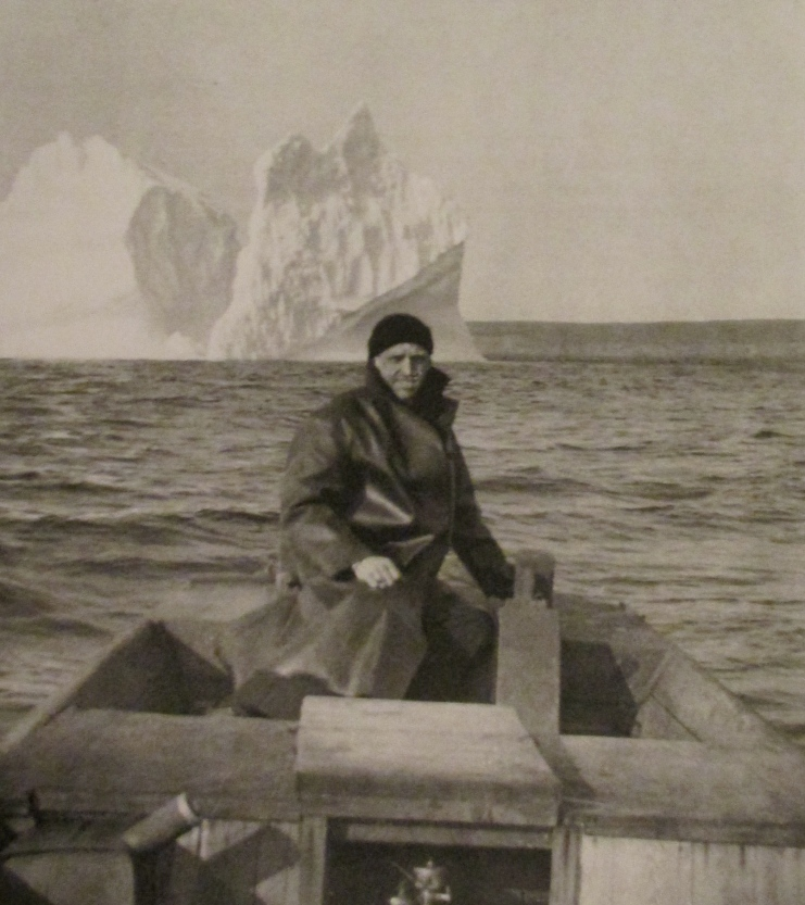 Musician 2nd Class Hap Saams is pictured in the stern of a local fishing boat with icebergs in the background off Argentia, Newfoundland during World War II when he was serving in the U.S. Navy. Photo provided