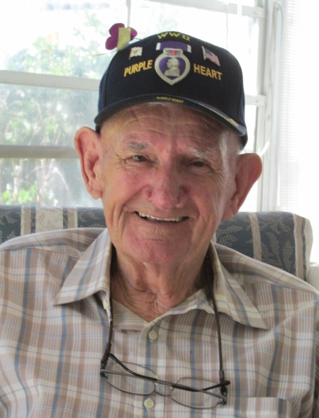 Mike Vucic of Port Charlotte wears his Purple Heart ball cap from his military service in World War II.  The 90-year-old served in Gen. Omar Bradley's 1st Army and Gen. George Patton's 3rd Army as well as the 7th and 15th Armies before he returned from the war. Sun photo by Don Moore
