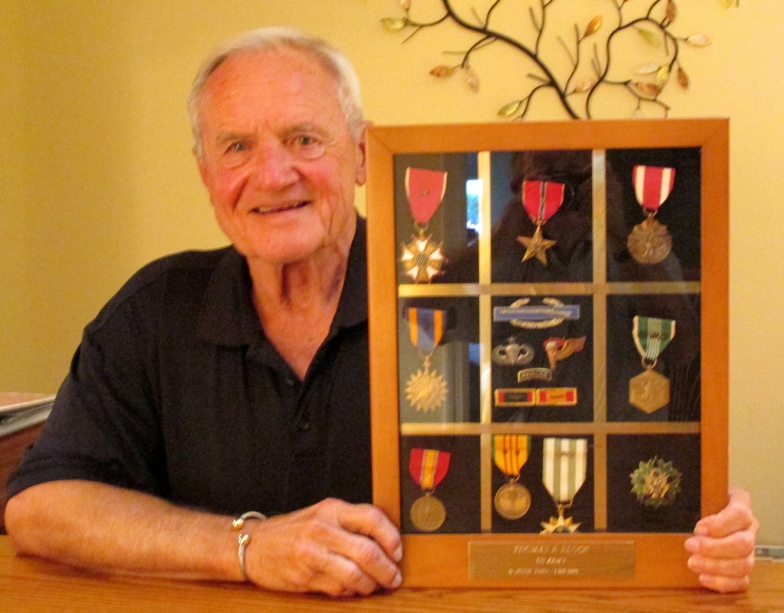 Lt. Col Tom Block holds a shadow box full of medals. He received Legion of Merit, Bronze Star, Combat Infantryman's Badge, Joint Commendation Medal, Air Medals Six awards, Army Commendation Medal 4 awards, Senior Paratroopers Badge, Pathfinder Badge and Ranger Badge