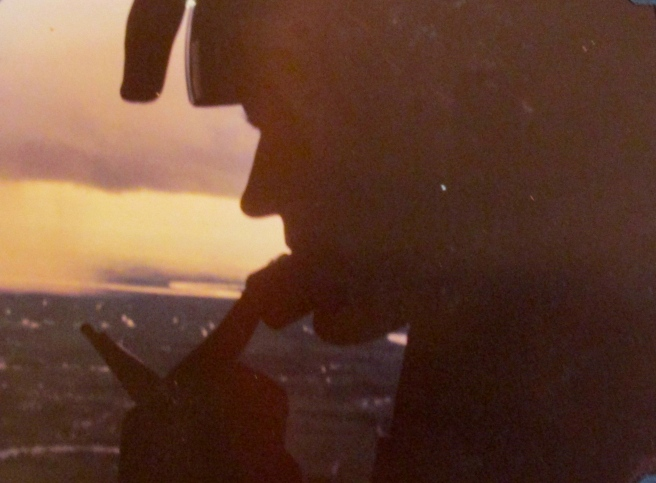This is Block in silhouette flying in a Huey helicopter above the battle field in Vietnam. He was operation officer for the 199th Infantry Battalion in 1968 at the time. Photo provided