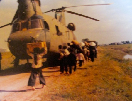 Refugees pile off an American Chinook helicopter at Nha Ben, Vietnam in 1968. Photo provided