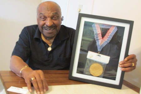 "John Newton of Port Charlotte holds a framed Congressional Gold Medal and Commendation he received in 2012 from the U.S. Congress at a ceremony in Washington, D.C. for his services as a black Marine in World War II. He was part of a group of blacks known as the ""Montford Point Marines"" who were awarded the highest civilian honor the government can bestow. Sun Photo by Don Moore"