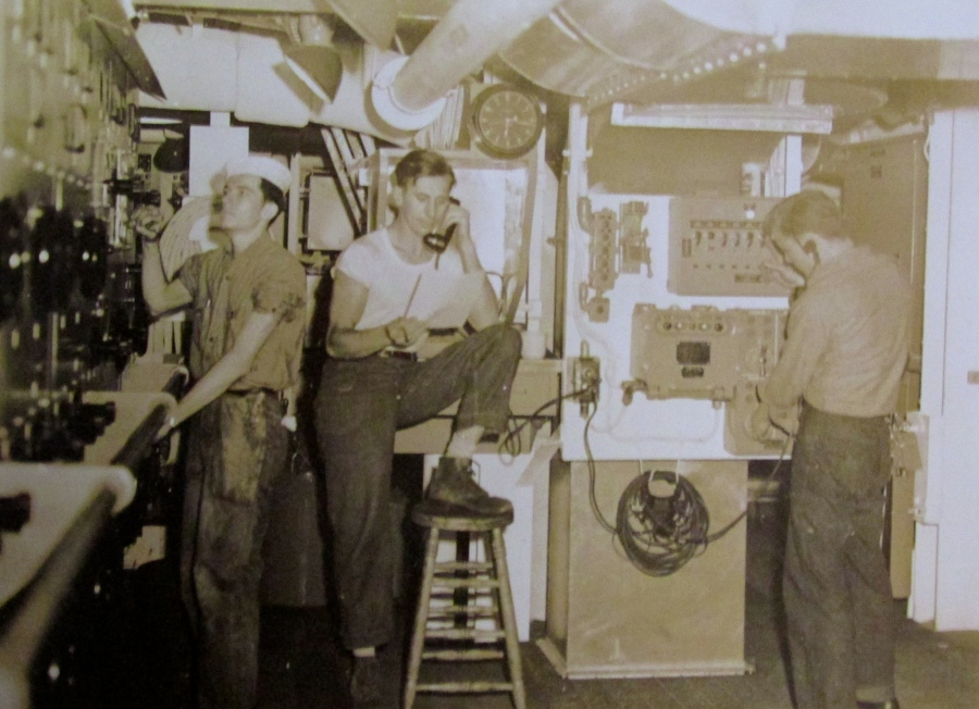 Electrician's mate 2nd Barrow (left) works on equipment aboard the Fletcher class destroyer, USS Aulick, in the Pacific Theatre of Operation during World War II. Photo provided.