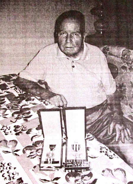Chuck Beaty of Port Charlotte is pictured with his commendations as an infantryman who fought in the North African and Sicilian campaigns during World War II. He received the Purple Heart and Silver Star among his commendations. Sun photo by Don Moore