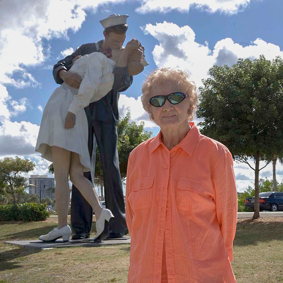 "Mary stands in front of the statue along the Sarasota Bayfront recently of photographer Alfred Eisenstaedt's famous ""Life"" photograph taken at Times Square on VJ-Day (Victory Over Japan) Aug. 14, 1945 at the end of World War. Photo By Tom O'Neill"