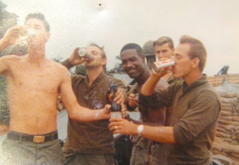 Nord and his buddies celebrate New Year's at Quế Sơn, Vietnam with a glass of champagne courtesy of a package he received by mail from his mother. Photo provided